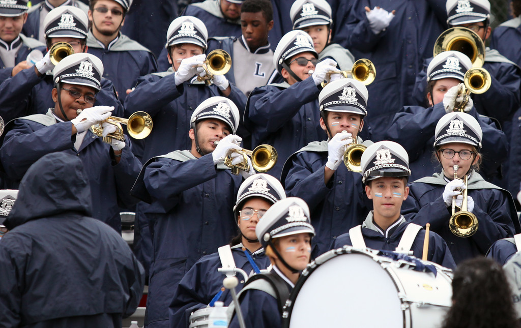 . Randy Meyers - The Morning Journal<br> The Lorain Titan band plays the fight song after a touchdown was scored against Elyria on Sept. 8.