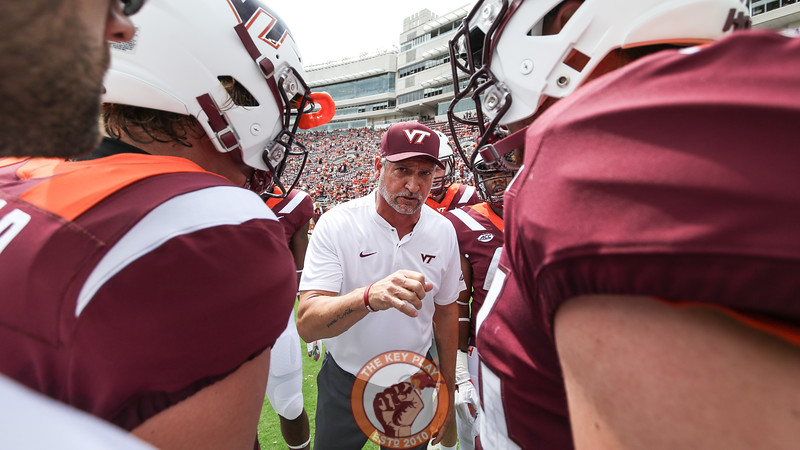 Defensive coordinator Bud Foster speaks with his linebackers after warmups. (Mark Umansky/TheKeyPlay.com
