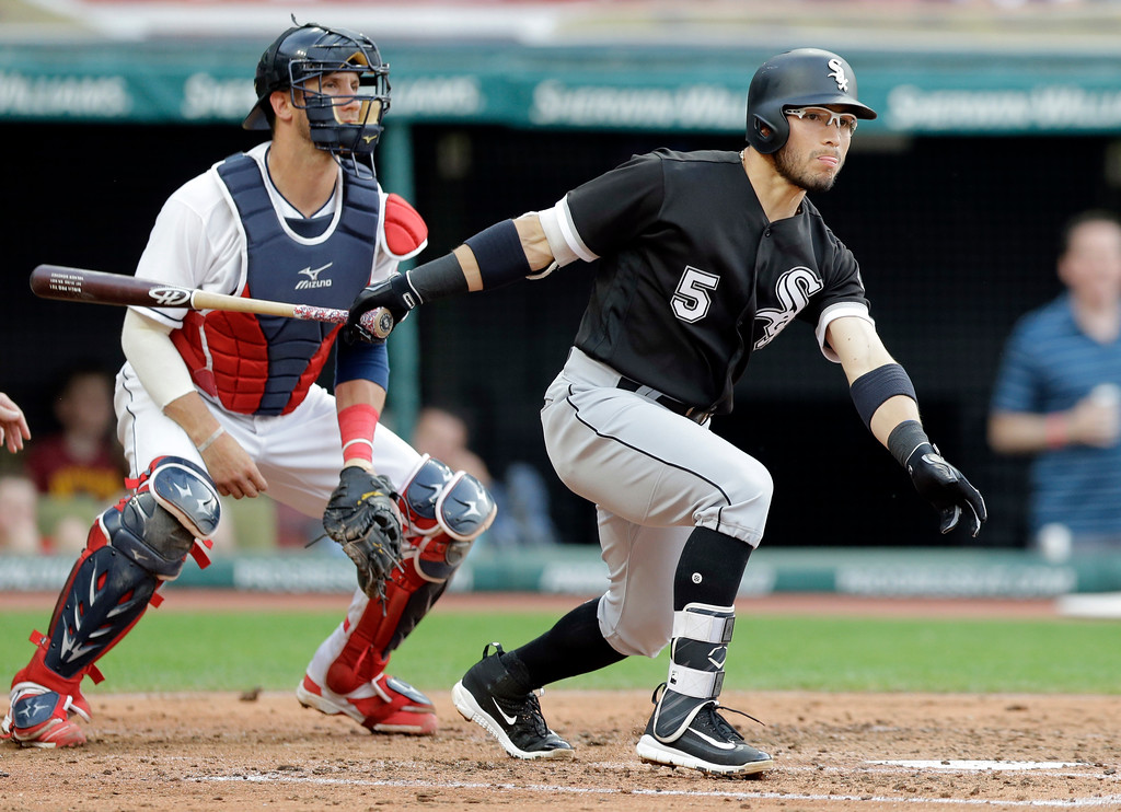 . Chicago White Sox\'s Yolmer Sanchez, right, watches his double off Cleveland Indians starting pitcher Josh Tomlin in the third inning of a baseball game, Saturday, June 10, 2017, in Cleveland. Indians catcher Yan Gomes, left, also watches. (AP Photo/Tony Dejak)