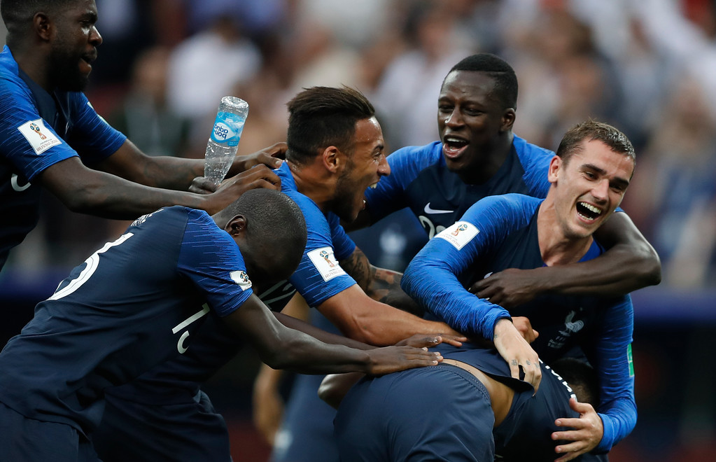 . France\'s Antoine Griezmann, right, celebrates with teammates after dance defeated Croatia to win the final match between France and Croatia at the 2018 soccer World Cup in the Luzhniki Stadium in Moscow, Russia, Sunday, July 15, 2018.France won the game 4-2. (AP Photo/Francisco Seco)