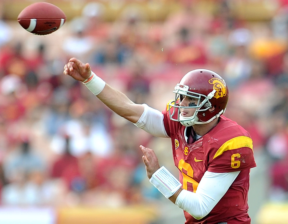 . Southern California quarterback Cody Kessler passes for a first down against Utah during the second half of an NCAA college football game in the Los Angeles Memorial Coliseum in Los Angeles, on Saturday, Oct. 26, 2013. Southern California won 19-3.   (Photo by Keith Birmingham/Pasadena Star-News)