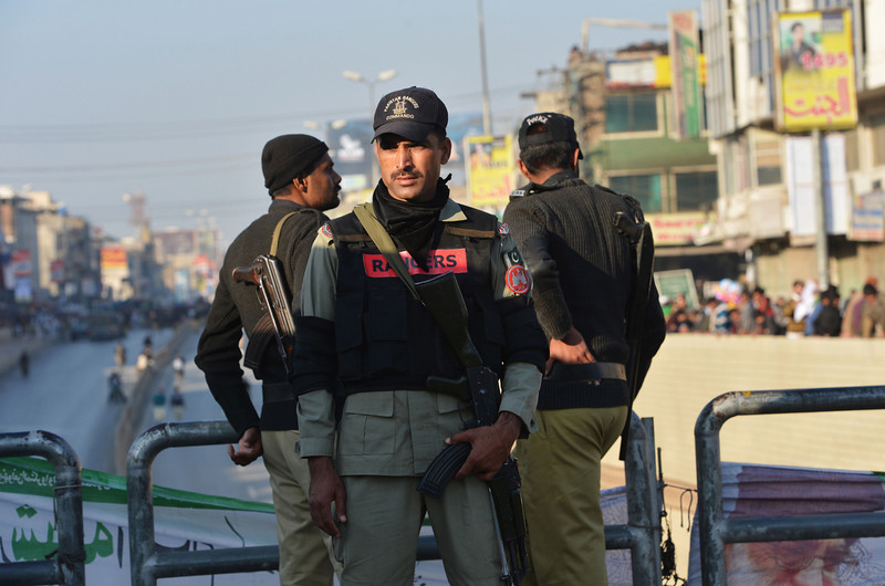 . Pakistani policemen and Rangers stand guard during celebrations marking Eid Milad-un-Nabi, the birthday of Prophet Mohammed, in Rawalpindi on January 14, 2014. Muslims across the world celebrated the birth of the Prophet Mohammed on 12 Rabil ul Awal, a month of the Muslim calendar. (FAROOQ NAEEM/AFP/Getty Images)