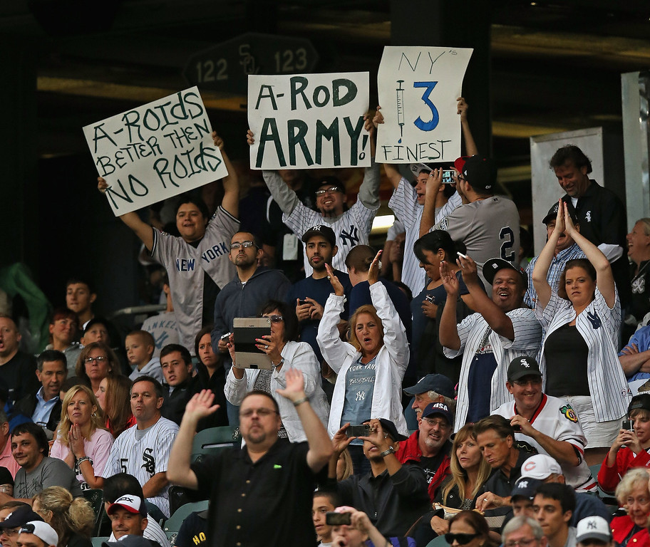 . Fans of the New York Yankees cheer and hold signs as Alex Rodriguez steps uo to bat against the Chicago White Sox at U.S. Cellular Field on August 5, 2013 in Chicago, Illinois.  (Photo by Jonathan Daniel/Getty Images)