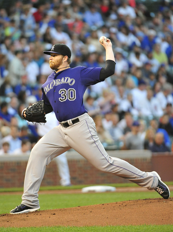 . CHICAGO, IL - JULY 30:  Brett Anderson #30 of the Colorado Rockies pitches against the Chicago Cubs during the first inning on July 30, 2014 at Wrigley Field in Chicago, Illinois. (Photo by David Banks/Getty Images)