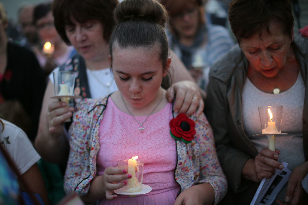 . STAFFORD, ENGLAND - AUGUST 04:  Visitors attend a Candlelit Vigil to mark the centenary of the First World War, at The National Memorial Arboretum on August 4, 2014 in Stafford, England. Monday 4th August marks the 100th anniversary of Great Britain declaring war on Germany. In 1914 British Prime Minister Herbert Asquith announced at 11pm that Britain was to enter the war after Germany had violated Belgium neutrality. The First World War or the Great War lasted until 11 November 1918 and is recognised as one of the deadliest historical conflicts with millions of causalities. A series of events commemorating the 100th anniversary are taking place throughout the day.  (Photo by Dan Kitwood/Getty Images)