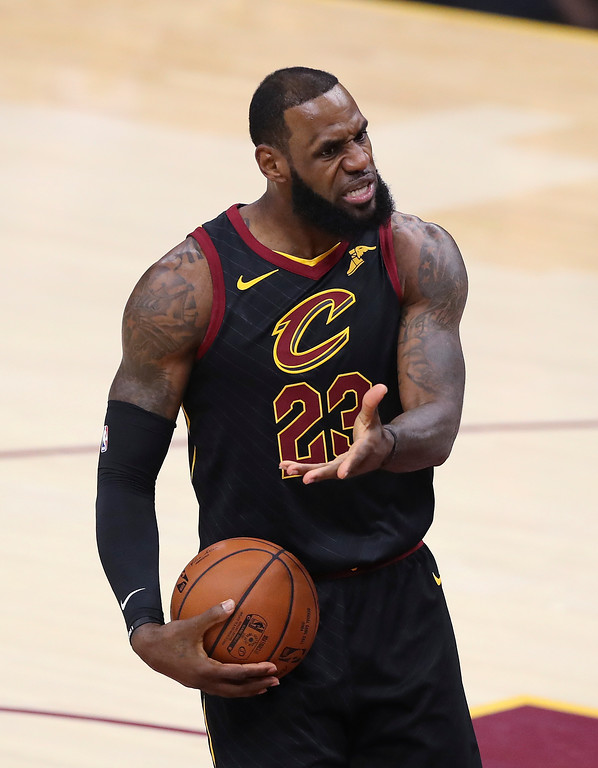 . Cleveland Cavaliers\' LeBron James questions a call during the first half of Game 4 of basketball\'s NBA Finals against the Golden State Warriors, Friday, June 8, 2018, in Cleveland. (AP Photo/Carlos Osorio)