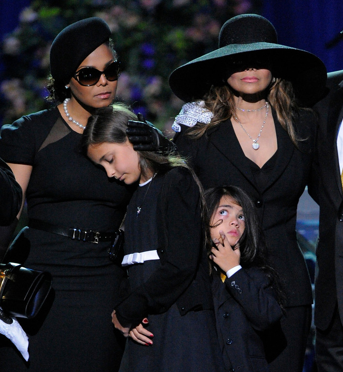 . In this July 7, 2009 file photo, singer Janet Jackson, left, Paris Katherine Jackson, second from left, Prince Michael Jackson II, and LaToya Jackson, right, are seen on stage during the memorial service for Michael Jackson at the Staples Center in Los Angeles. (AP Photo/Mark J. Terrill, file)