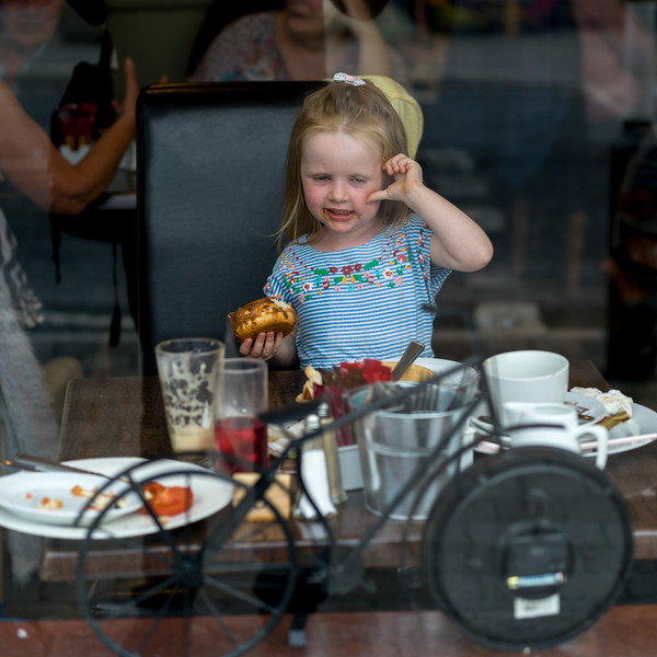 Girl eating food in restaurant, Ennistimon, County Clare, Republic of Ireland