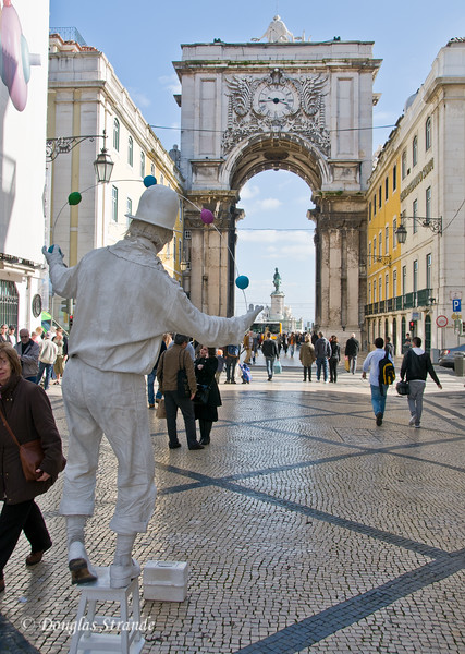 Thur 3/17 in Lisbon:  Looking through the Triumphal Arch to the statue of King Jose I  on the waterfront