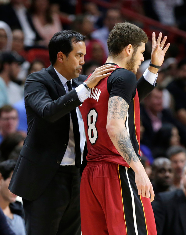 . Miami Heat head coach Erik Spoelstra, left, talks with Miami Heat\'s Tyler Johnson (8) during the first half of an NBA basketball game against the Cleveland Cavaliers, Saturday, March 4, 2017, in Miami. (AP Photo/Lynne Sladky)