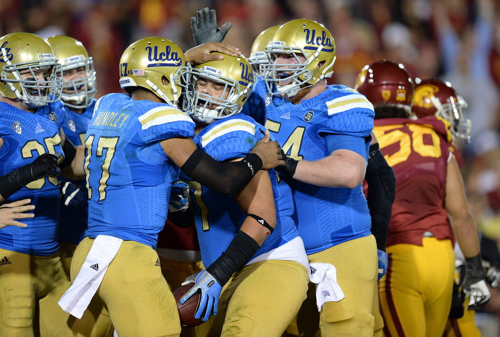 . UCLA�s Eddie Vanderdoes #47is congratulated by teammates after scoring a touchdown during their game against USC at the Los Angeles Memorial Coliseum Saturday, November 30, 2013.  (Photo by Hans Gutknecht/Los Angeles Daily News)