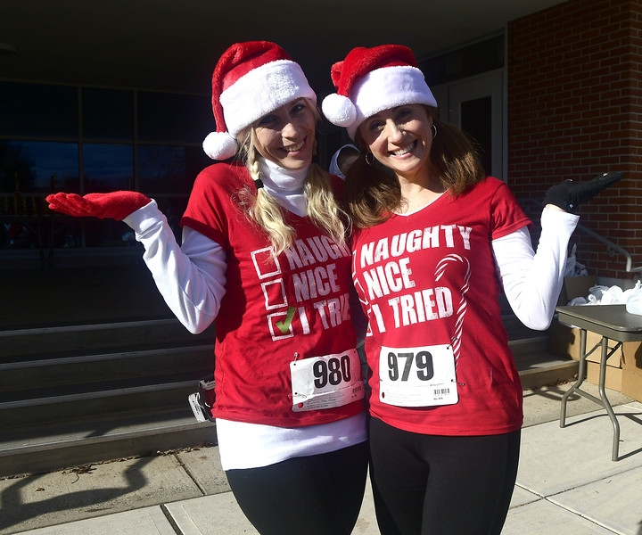 12/3/2016 Mike Orazzi | Staff Runners Brandy Graham and Kate Vogel during the 32nd installment of the Annual Tinsel Fun Run at Berlin High School Saturday morning put on by the Berlin YMCA and the Berlin Parks and Recreation Department. "|720|600|?|en|2|d72b5bed8f46fad77afd457cd4956b62|False|UNLIKELY|0.32577261328697205