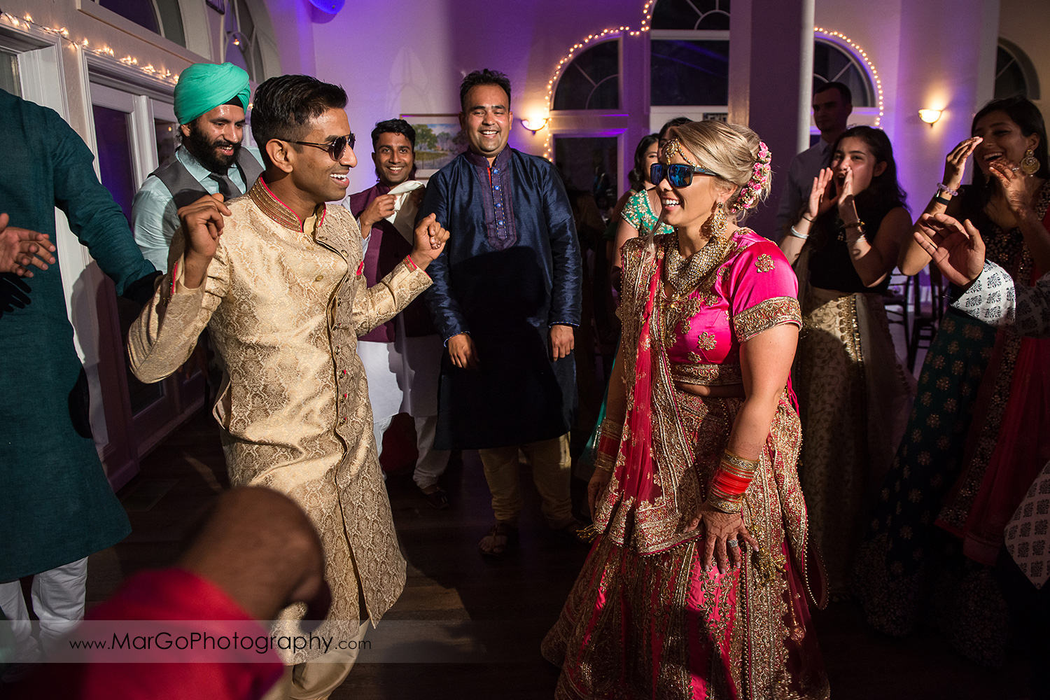 Indian bride and groom dancing durng wedding reception at Elliston Vineyards in Sunol