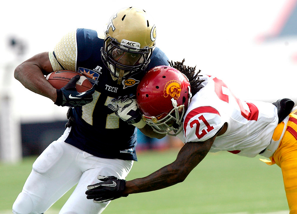 . Georgia Tech running back Orwin Smith, left, rushes in for a touchdown against Southern California\'s Nickell Robey during the Sun Bowl NCAA college football game, Monday, Dec. 31, 2012, in El Paso, Texas. Georgia Tech won 21-7. (AP Photo/Mark Lambie)