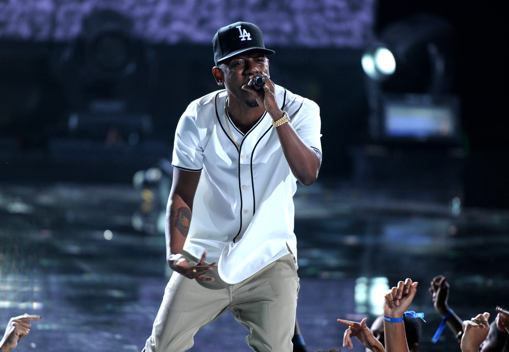 Description of . Kendrick Lamar performs onstage at the BET Awards at the Nokia Theatre on Sunday, June 30, 2013, in Los Angeles. (Photo by Frank Micelotta/Invision/AP)