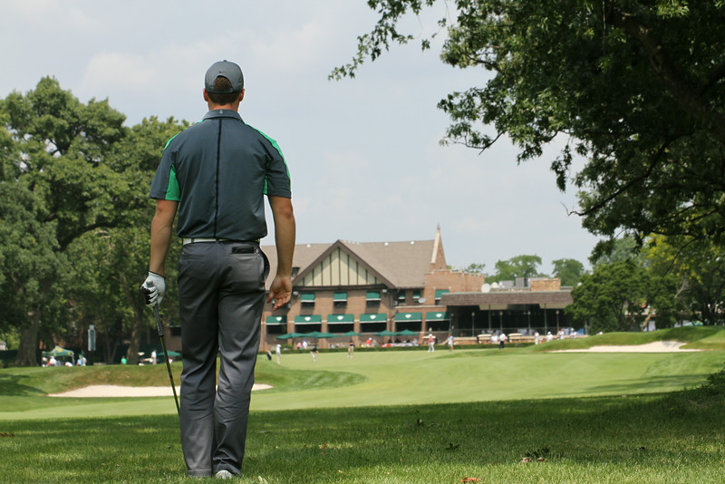 Wyndham Clark of Greenwood Village, Colorado lines up a shot on the 18th hole during the first round of the 2014 Western Amateur.