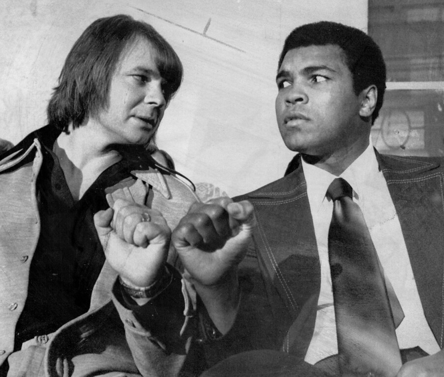 . Who\'s The Real Fisticuffs Man?--Oakland Raiders quarterback Ken Stabler, left, and Muhammad Ali, world heavyweight box champion, mockingly glare at each, other as they compare fists during a press conference in New York Monday. Stabler and Ali were among 33 athletes in different fields selected by sportswriters for the third annual Gillette Cavalcade of Champions Awards. Sports fan across the country will vote to select the outstanding athletes of the year from the ballot and the results were be announced on NBC. 1975 Credit: AP Wirephoto