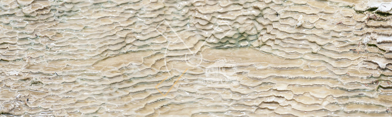 Abstract patterns creating brown mini natural terraces at the Artist's palette and Primrose terraces of the Waiotapu geothermal area in Rotorua