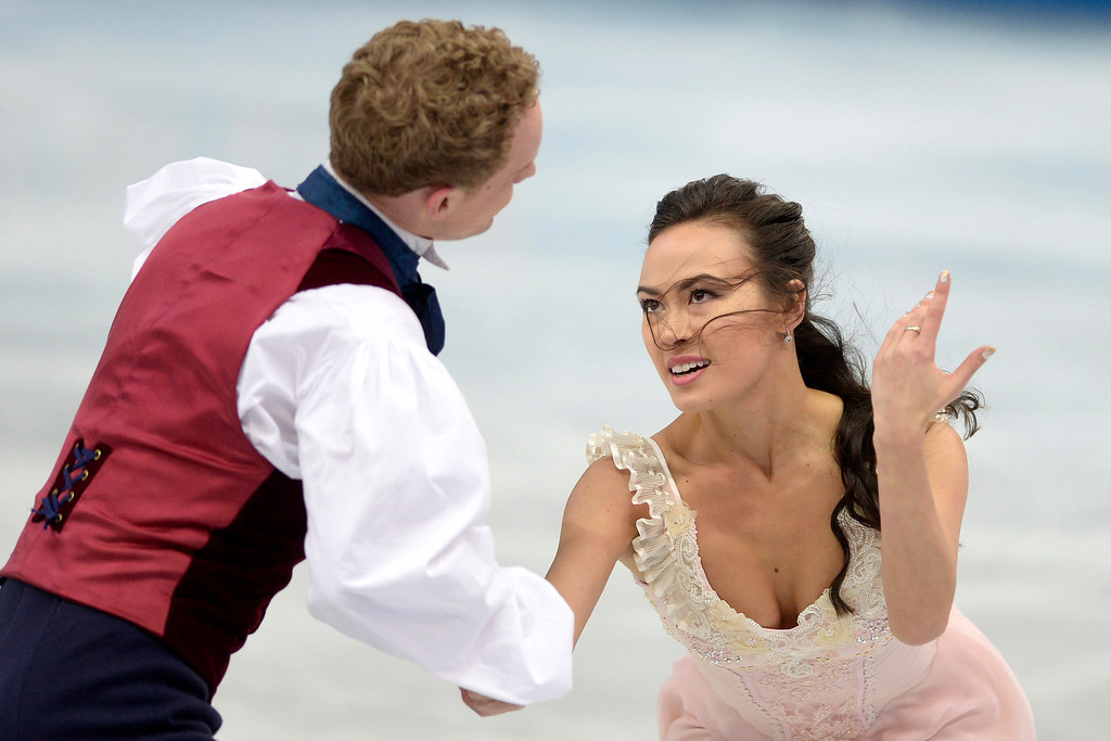 . American skaters Evan Bates and Madison Chock perform during the figure skating ice dancing free dance medal round. Sochi 2014 Winter Olympics on Monday, February 17, 2014. (Photo by AAron Ontiveroz/The Denver Post)