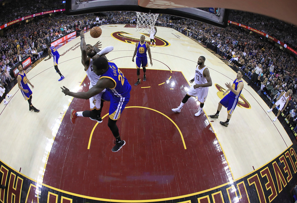 . Golden State Warriors forward Draymond Green (23) fouls Cleveland Cavaliers guard Kyrie Irving during the first half of Game 4 of basketball\'s NBA Finals in Cleveland, Friday, June 9, 2017. (Ronald Martinez/Pool Photo via AP)