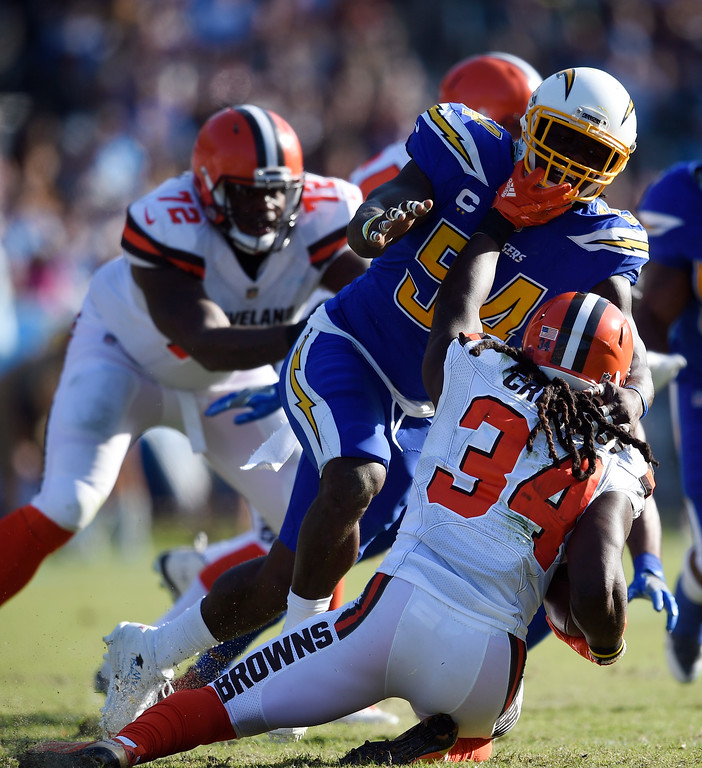 . Cleveland Browns running back Isaiah Crowell, bottom, is tackled by Los Angeles Chargers defensive end Corey Liuget during the first half of an NFL football game Sunday, Dec. 3, 2017, in Carson, Calif. (AP Photo/Kelvin Kuo)