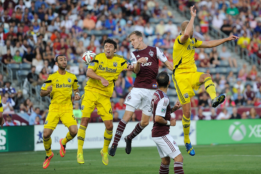 . Jared Watts #33 of the Colorado Rapids goes up for a header with Michael Parkhurst #4 of the Columbus Crew and Eric Gehrig #16 of the Columbus Crew as Justin Meram #9 of the Columbus Crew looks on after Rapids corner kick during the first half of an MLS game at Dick\'s Sporting Goods Park on July 4, 2014, in Commerce City, Colorado. The Rapids and Crew drew 1-1. (Photo by Daniel Petty/The Denver Post)