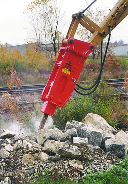 NPK E205 hydraulic hammer on Cat backhoe (2).jpg