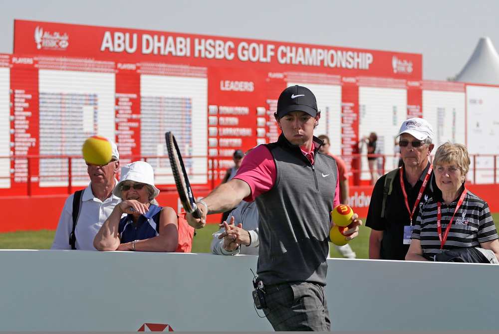 Description of . Rory McIlroy of Northern Ireland plays tennis in the spectator village during the first round of the Abu Dhabi HSBC Golf Championship at Abu Dhabi Golf Club on January 17, 2013 in Abu Dhabi, United Arab Emirates.  (Photo by Scott Halleran/Getty Images)