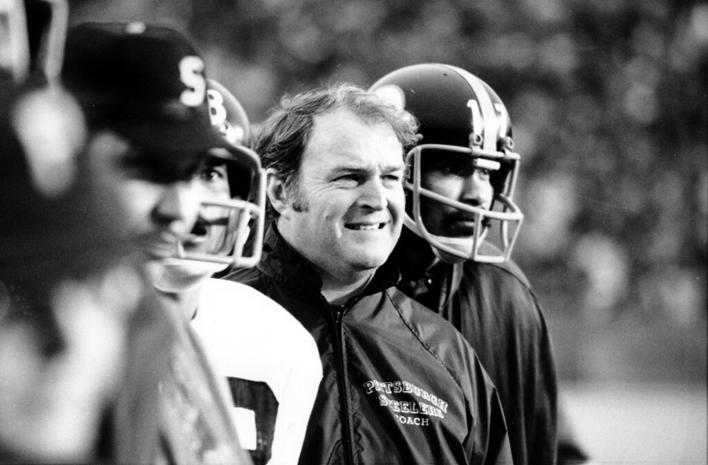 . Pittsburgh Steelers coach Chuck Noll smiles as he watches his team play to a 16-6 victory over the Minnesota Vikings during the Super Bowl IX game at Tulane Stadium in New Orleans, La., on Jan. 12, 1975.  At right is Joe Gilliam (17).  (AP Photo)