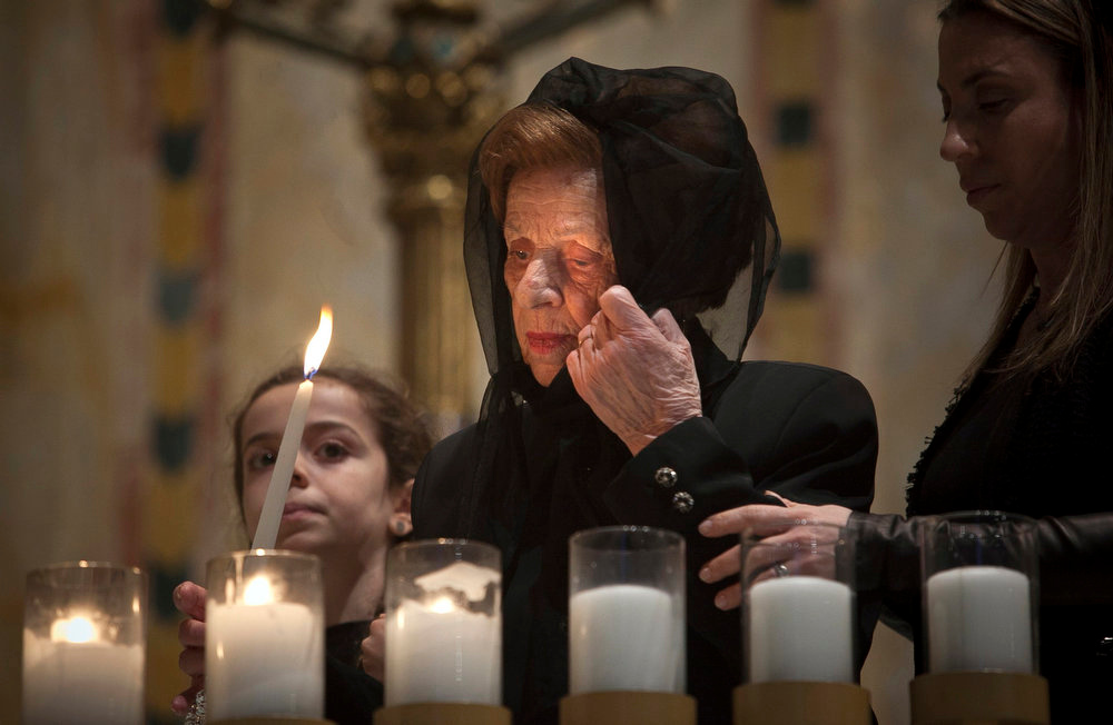 . A holocaust survivor lights a symbolic candle at the Temple Emanu-El during the annual Holocaust Remembrance Day in New York on April 7, 2013. The day brings together Holocaust survivors and their families to remember the 6 million Jews who were murdered during the Holocaust. REUTERS/Allison Joyce