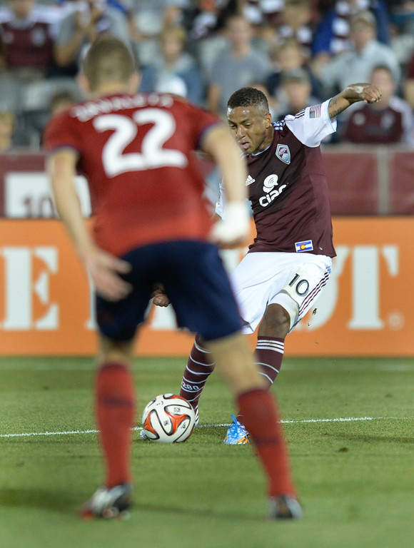 . Colorado forward Gabriel Torres (10) put a shot past Chivas defender Eriq Zavaleta (22) for a goal in the second half. The Colorado Rapids defeated Chivas USA 3-0 at Dick\'s Sporting Goods Park Friday night, July 25, 2014. Photo by Karl Gehring/The Denver Post