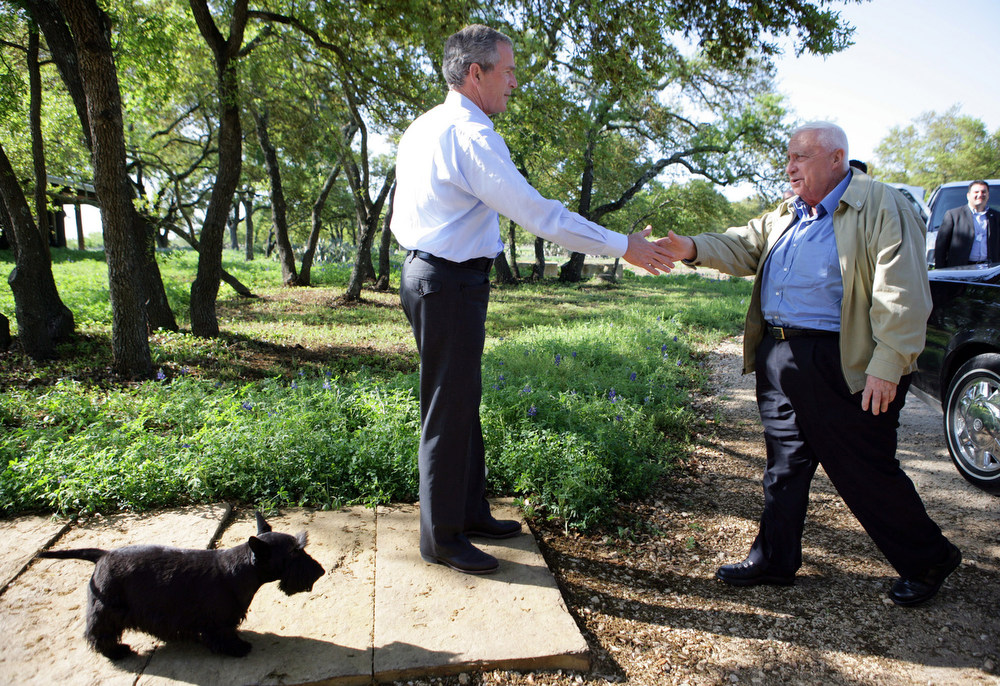Description of . In this photo provided by the White House,  President Bush greets Israeli Prime Minister Ariel Sharon upon Sharon's arrival to the President's ranch in Crawford, Texas, Monday, April 11, 2005. The president's dog Barney looks on at left.  Bush met with Sharon on Monday to offer support for his controversial Gaza pullout plan that the Israeli leader said has generated an atmosphere approaching civil war. (AP Photo/White House,Eric Draper)