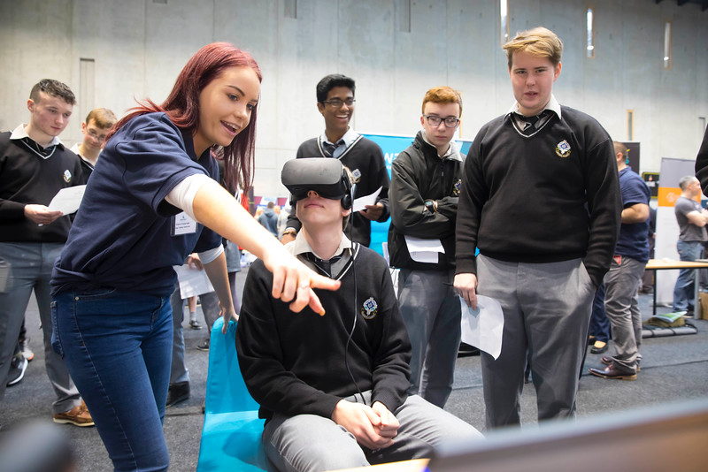 """09/11/2017. Crystal Valley Tech Showcase at WIT Arena. Pictured is Vincent Gornicki from St Kieran's College, Kilkenny with Claire Coppinger from Bluefin with a VR Head Set. Picture: Patrick Browne  Event demonstrates Tech and ICT is thriving in Kilkenny and the South East 50 companies and 2,000 students, industry and recruiters attend the inaugural Crystal Valley Tech Showcase event  Over 50 companies who are working together as Crystal Valley Tech showcased their rapidly growing industry in the WIT Arena on Thursday morning to approx. 2,000 members of the public, college and second level students, recruiters, government agencies and other industry.  The future is bright for ICT in the South East according to Dr Padraig Kirwan, Head of the Department of Computing & Mathematics at Waterford Institute of Technology. """"Computing is thriving in the South East judging by the number and diversity of ICT companies here today. Even more encouraging is the number of second level students who attended from Waterford, Kilkenny, Carlow, Tipperary and Wexford and how interested they are about the career opportunities in this exciting industry.""""  Kilkenny schools attending the event included St Kieran's College,  VTOS Kilkenny and Presentation Secondary School in Loughboy.  Elaine Fennelly, Bluefin Payment Systems General Manager and co-founder of Crystal Valley Tech is very excited about the industry in the South East and today's showcase event. """"People who work in the industry already know that Tech is well established in the South East and the number of opportunities and companies continues to grow and grow. According to a recent Tech Ireland report there are over 60 indigenous and multinational companies employing well over 1,500 people from their bases in Waterford, Wexford, Kilkenny and Carlow.  """"However, we weren't so sure that people in the region realised just how big the ICT industry is becoming and to ensure the industry's future growth in the South Eas"""