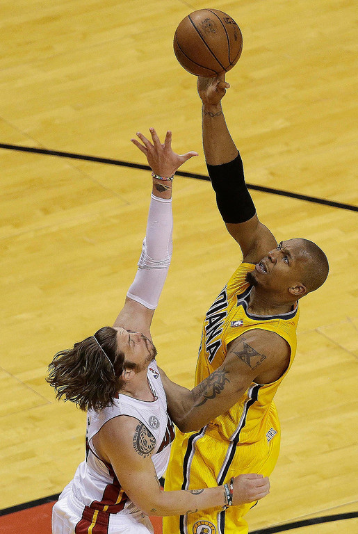 . Indiana Pacers power forward David West (21) shoots over Miami Heat shooting guard Mike Miller (13) during the second half of Game 7 in their NBA basketball Eastern Conference finals playoff series, Monday, June 3, 2013 in Miami. (AP Photo/Wilfredo Lee)