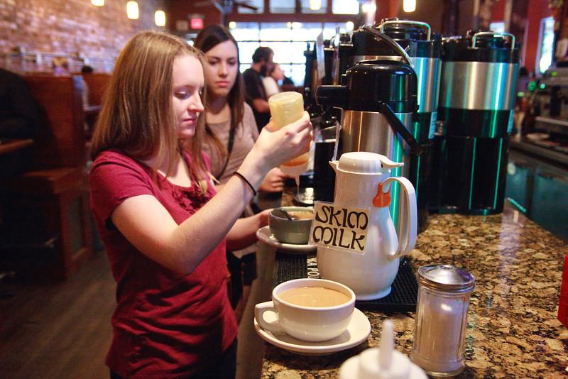 Lauren making her coffee.