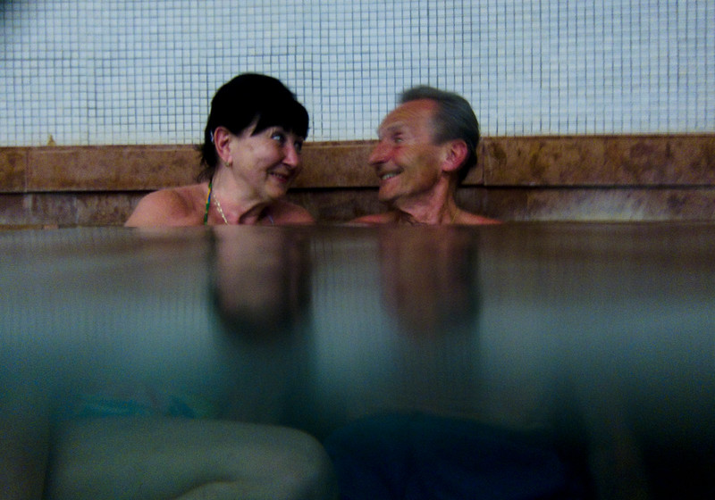 March , 2012, Budapest, Hungary - A German tourist and his girlfriend enjoy the hot bath at Gellert Bath and SPA.  Budapest is known as the SPA Capital of the world.  Nearly 120 hot springs feed the city's historic thermal baths (Furdo) and approximately 70 million litres of water used every day.
