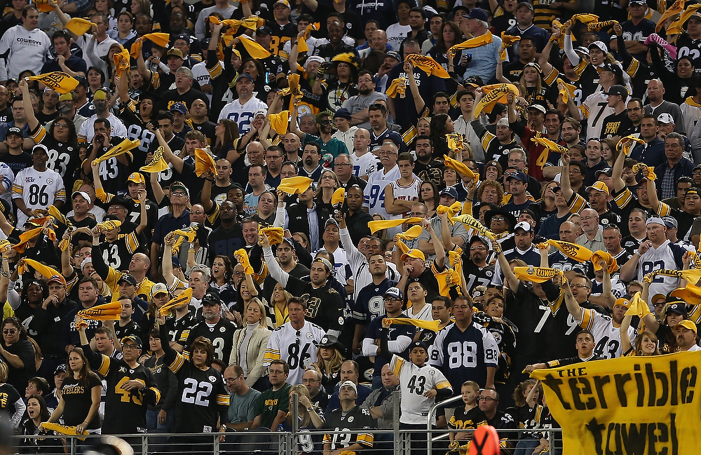 Description of . Pittsburgh Steelers fans wave towels during a game against the Dallas Cowboys at Cowboys Stadium on December 16, 2012 in Arlington, Texas.  (Photo by Ronald Martinez/Getty Images)