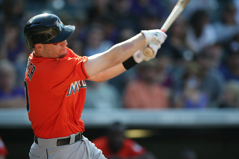 . Miami Marlins\' Jeff Baker follows the flight of his RBI-double against the Colorado Rockies in the seventh inning of the Rockies\' 7-4 victory in a baseball game in Denver on Sunday, Aug. 24, 2014. (AP Photo/David Zalubowski)