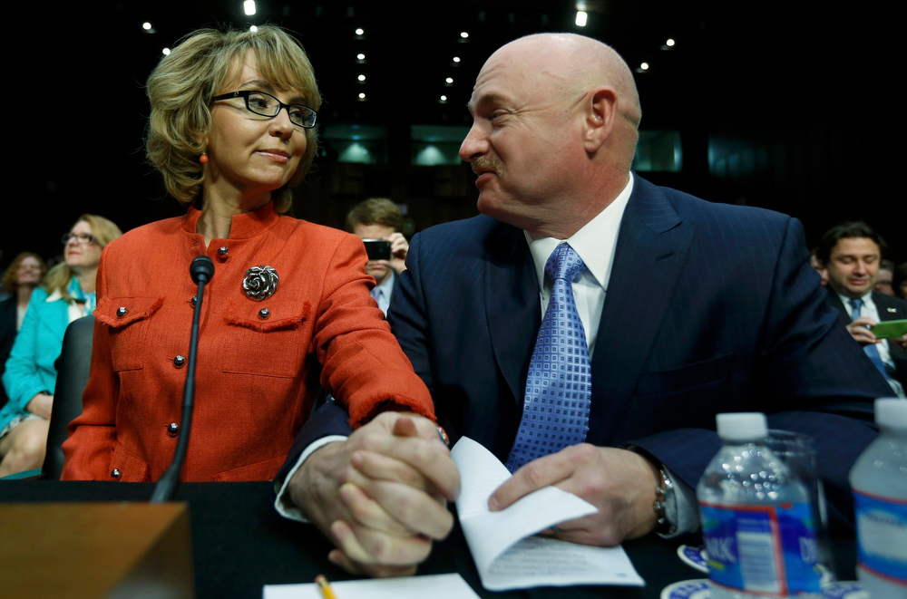 Description of . Former U.S. Rep. Gabrielle Giffords sits with her husband, retired U.S Navy Captain Mark Kelly, prior to delivering a statement at a Senate Judiciary Committee hearing on gun violence, on Capitol Hill in Washington January 30, 2013. The hearing comes six weeks after the massacre of 26 people at a Connecticut school ignited new calls to fight gun-related violence. REUTERS/Kevin Lamarque