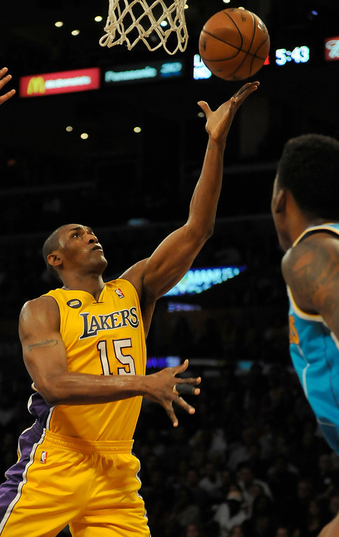 . Lakers#15 Metta World Peace drives the lane in the first half. The Lakers played the New Orleans Hornets at Staples Center in Los Angeles CA 4/9/2013(John McCoy/Staff Photographer