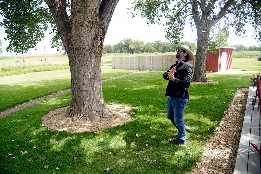 . KERSEY, CO - AUGUST 14: Todd Helton hits a chip shot at his ranch. Former Colorado Rockies first baseman Todd Helton was photographed at his ranch on Thursday, August 14, 2014. (Photo by AAron Ontiveroz/The Denver Post)