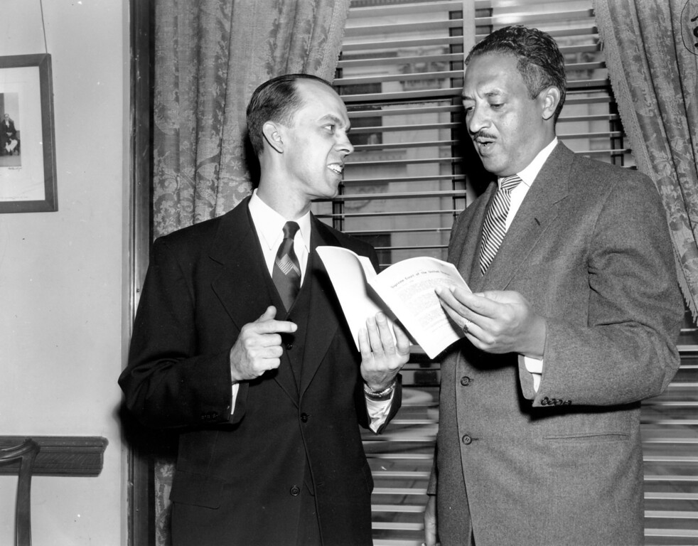 . Thurgood Marshall, of New York City, right, the chief attorney for black parents in segregation litigation, and Spottwood W. Robinson III, of Richmond, Va., confer in Washinton, D.C. on April 12, 1955.  Marshall is about to ask the U.S. Supreme Court to decree that separate schools for black and white children must end at thestart of the new school term in September.  (AP Photo)