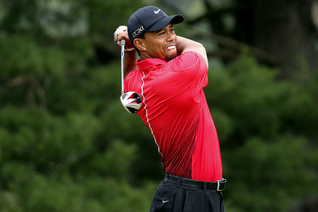 . ARDMORE, PA - JUNE 16:  Tiger Woods of the United States hits his tee shot on the third hole during the final round of the 113th U.S. Open at Merion Golf Club on June 16, 2013 in Ardmore, Pennsylvania.  (Photo by Rob Carr/Getty Images)