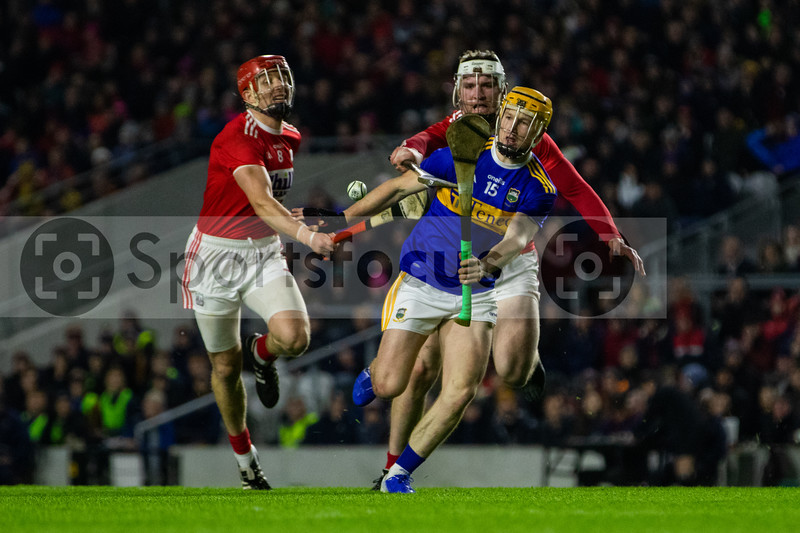 Tipperary's Jake Morris is challenged by Cork's Bill Cooper and Chris O'Leary
