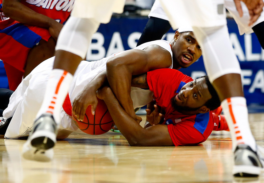 . BUFFALO, NY - MARCH 22: C.J. Fair #5 of the Syracuse Orange and Khari Price #0 of the Dayton Flyers battle for a loose ball during the third round of the 2014 NCAA Men\'s Basketball Tournament at the First Niagara Center on March 22, 2014 in Buffalo, New York.  (Photo by Jared Wickerham/Getty Images)