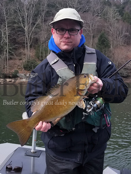 Jason Venesky with Piney Dam smallmouth bass.  Knapp photo