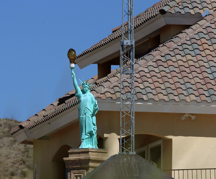 A house on the hill sports its own Statue of Liberty.