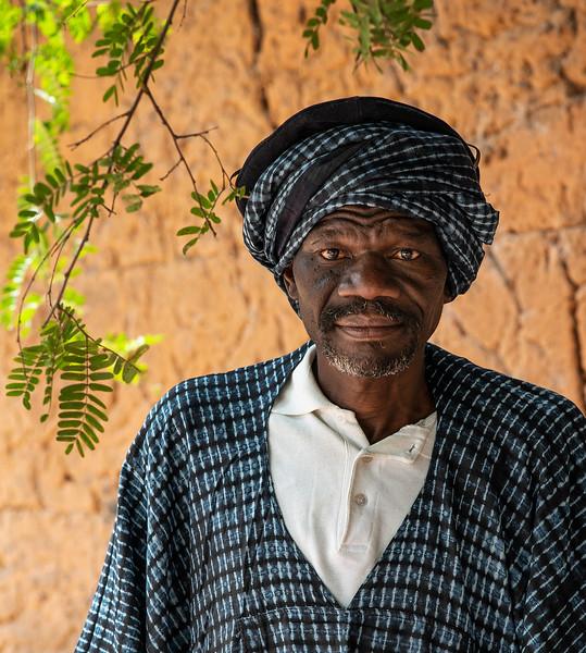 Portrait of a Jola man in traditional dress.  Senegal 2020