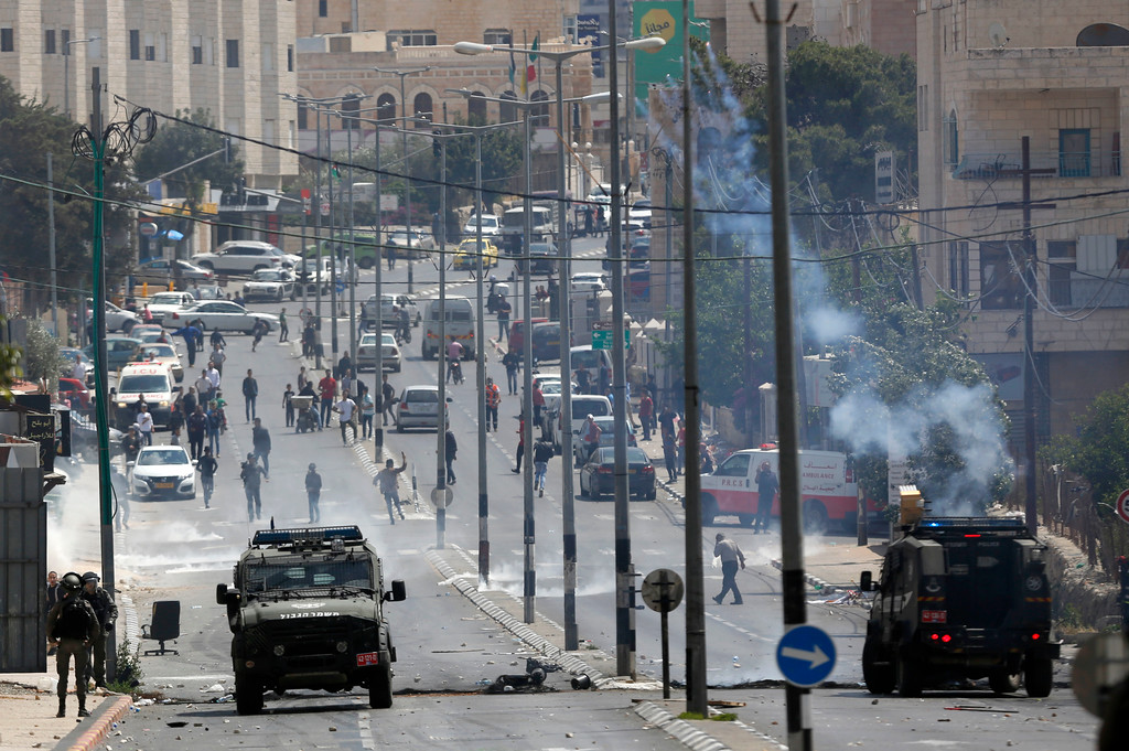 . Palestinians clash with Israeli troops following a protest against the opening of the U.S. embassy in Jerusalem, in the West Bank city of Bethlehem, Monday, May 13, 2018. (AP Photo/Majdi Mohammed)
