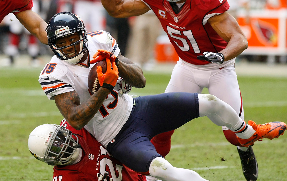 . Chicago Bears wide receiver Brandon Marshall (15) is tackled by Arizona Cardinals cornerback Patrick Peterson (21) during the first half of an NFL football game, Sunday, Dec. 23, 2012, in Glendale, Ariz. (AP Photo/Rick Scuteri)